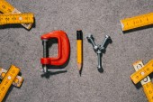 top view of word diy made of tools on grey surface