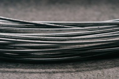 selective focus of grey wires on tabletop