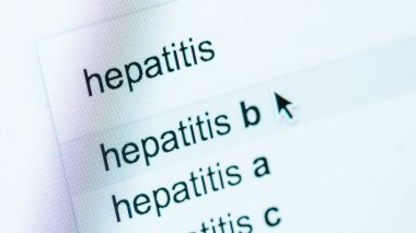 close up view of computer screen with lettering hepatitis a, b, c, world hepatitis day concept
