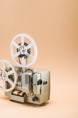 Close up view of old film projector on beige background stock vector