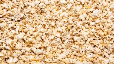 full frame of arranged popcorn as background