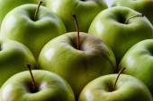 full frame of ripe green apples background