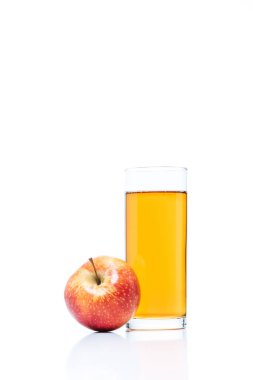 Close up view of glass of apple juice and fresh apple isolated on white stock vector