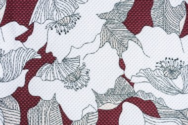 full frame image of textile fabric with pattern of flowers background