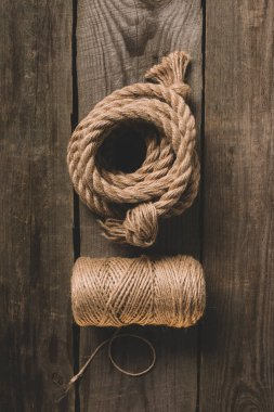 top view of two various beige ropes on wooden background