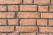 Fotografie Detailní pohled hnědé věku cihlová zeď na pozadí