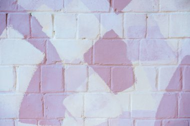 Light brick wall with white and pink paint, abstract background stock vector