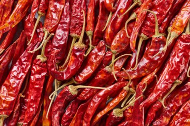 full frame of red dried chili peppers as background