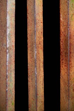 Close up view of rust fence with black background behind stock vector
