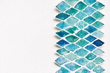 top view of abstract template made of blue and green watercolor paints on white background