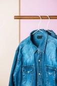 Photo casual denim shirts on hangers, fashion industry