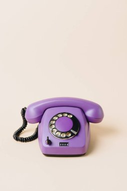 One purple vintage telephone on beige stock vector