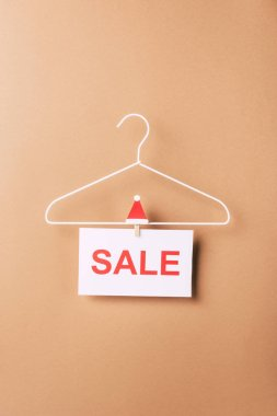 Hanger with sale sign for christmas shopping on beige stock vector