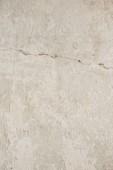 Detailní záběr Staré světle béžové betonové zdi
