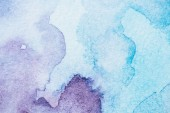 Fotografie handmade light blue and purple watercolor background