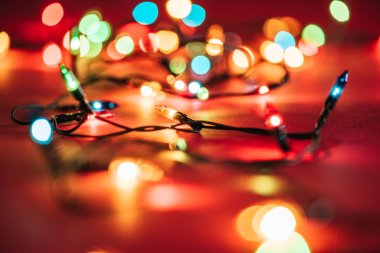 blurred shining colourful garlands as christmas background