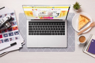 Office desk with laptop and aliexpress website on screen, flat lay stock vector