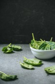 Green and healthy spinach leaves in bowl