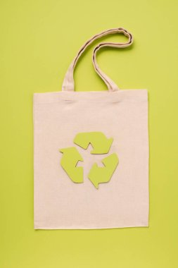 Tissue bag with recycle sign on yellow background