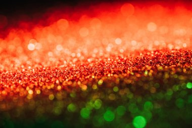 Glowing christmas texture with red and green blurred glitter stock vector