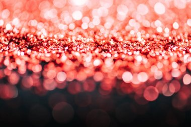 Glowing christmas background with red defocused glitter stock vector