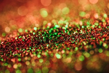 Glowing christmas texture with colorful blurred glitter stock vector