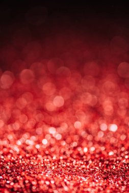 Abstract christmas background with red defocused glitter stock vector