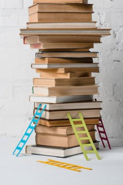 close-up view of pile of books and small step ladders, education and reading concept