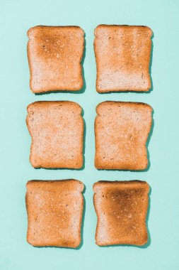 top view of assembled crispy toasts on blue surface