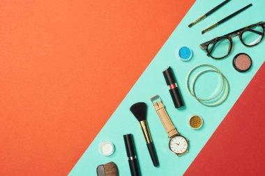 Mascara, watch, lipstick, bracelets, eyeshadow, blush, glasses and cosmetic brushes on turquoise background stock vector