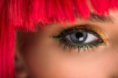 Fotografie cropped image of attractive woman with red hair and makeup looking at camera