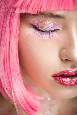 cropped image of attractive woman with pink hair and glitter on face