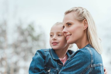 happy family of blonde mother and adorable daughter