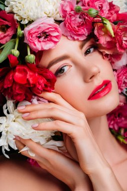 Close-up portrait of beautiful young woman in floral wreath looking at camera stock vector