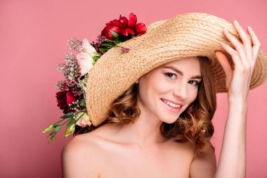 Beautiful naked girl in hat with flowers smiling at camera isolated on pink stock vector