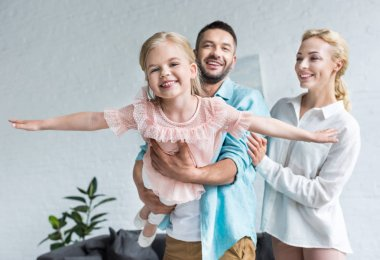 happy family with one child having fun together at home