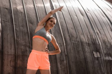 beautiful sportive girl stretching in sports bra