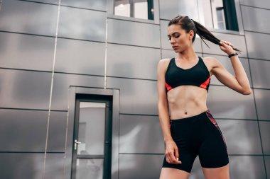 attractive young sportswoman posing in sportswear