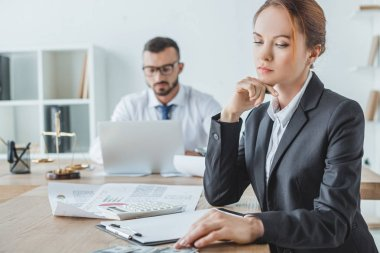 accountants working in office with documents and laptop
