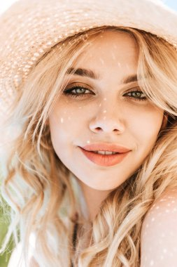 Portrait of beautiful young blonde woman in straw hat smiling at camera stock vector