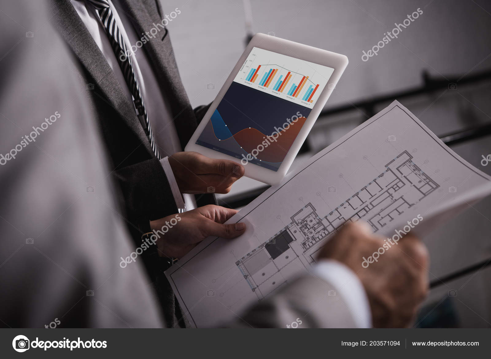 Cropped view engineers blueprint digital tablet graphs screen cropped view engineers blueprint digital tablet graphs screen stock photo malvernweather Gallery