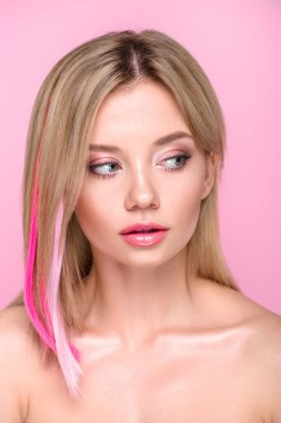 close-up portrait of beautiful young woman with colorful hair strands isolated on pink