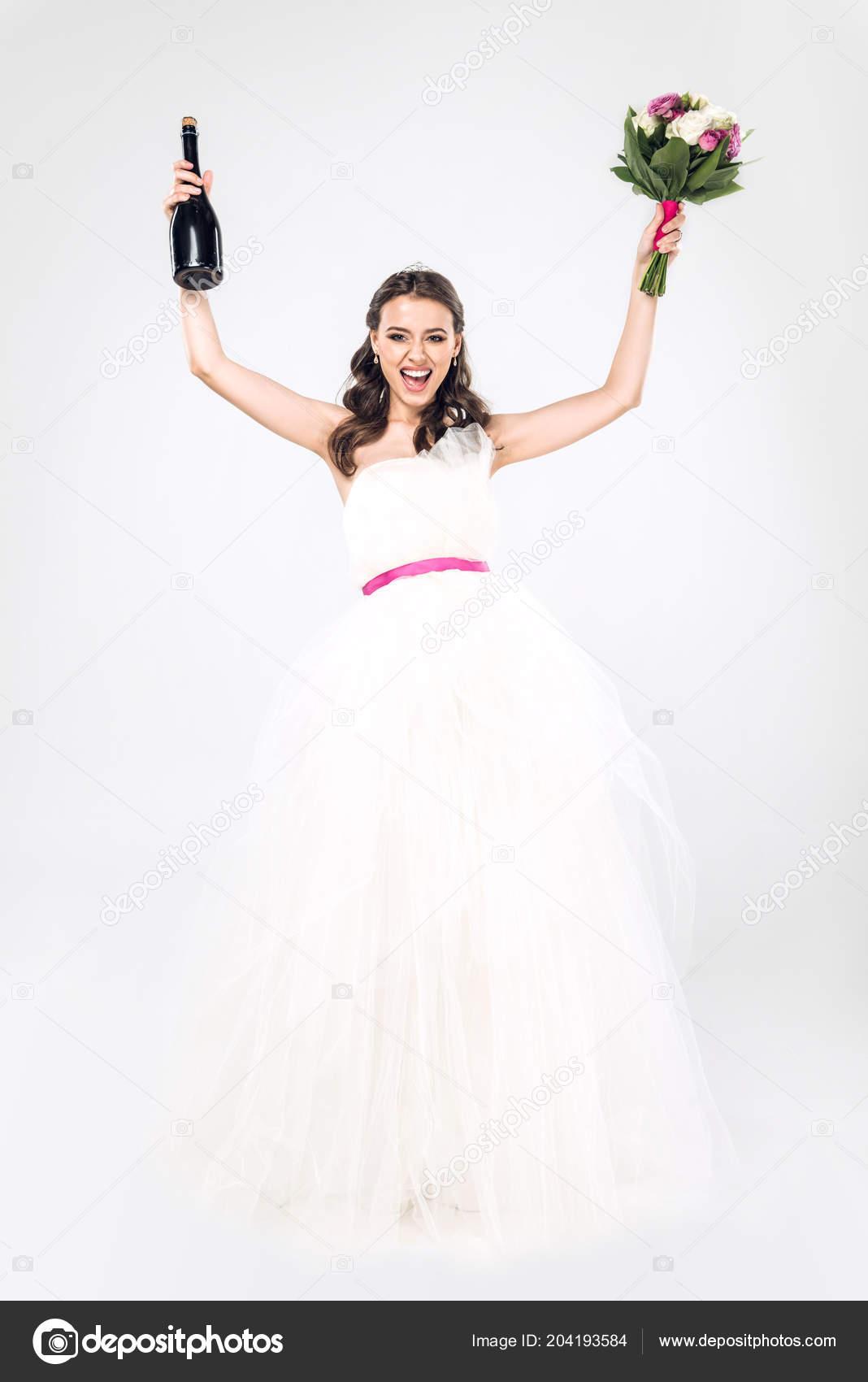 Celebrating Young Bride Wedding Dress Champagne Bottle Bridal ...