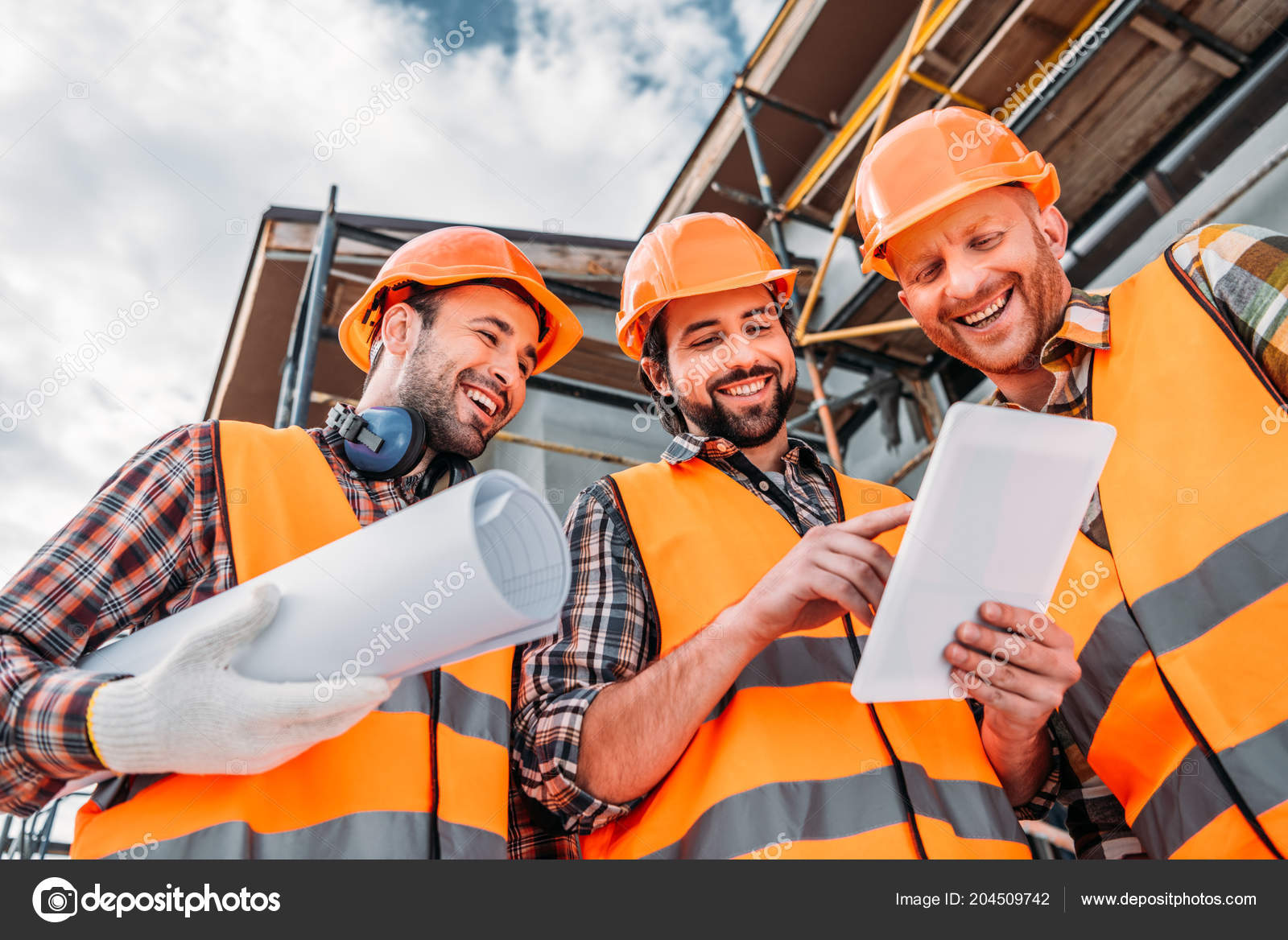 Bottom view group builders blueprint tablet construction site bottom view group builders blueprint tablet construction site stock photo malvernweather Images