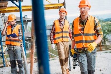 group of builders working together at construction site