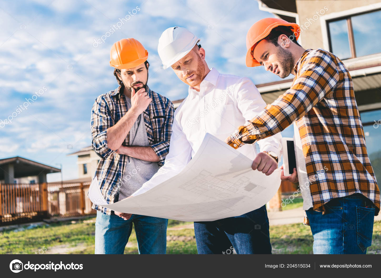 Group handsome architects blueprint garden construction site stock group handsome architects blueprint garden construction site stock photo malvernweather Images