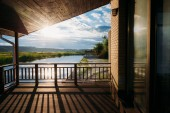 scenic view of beautiful sunset over river from wooden terrace