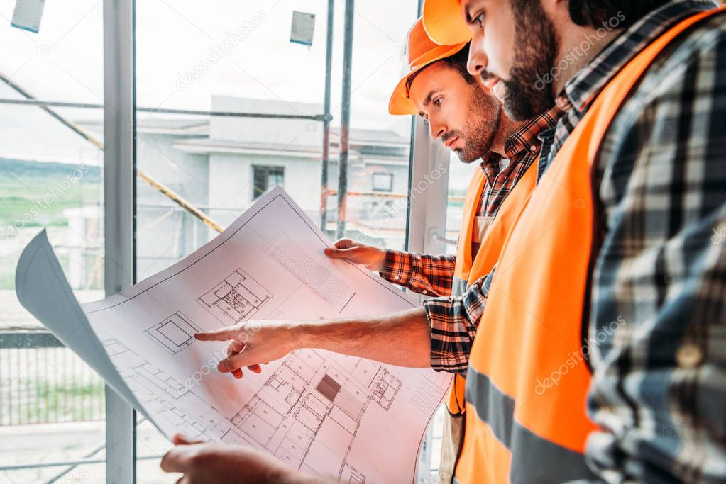Thoughtful builders working with blueprint at construction site stock vector