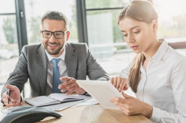 successful young businessman and businesswoman working together at modern office