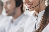 Fotografie cropped shot of smiling young call center manageress working with colleagues